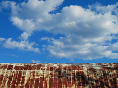 Divisions #1: Barn Roof (duaneschermerhorn) Tags: old blue roof shadow red sky white abstract tree clouds barn rust rustic redpaint