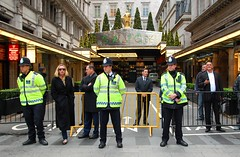 Life Goes On (For Some) (Gaz-zee-boh) Tags: london protest police menatwork demonstration thestrand n30 metropolitanpolice savoyhotel workwear londonist thesavoy londonalt condem highvisibiltyclothing artofimages defendpublicservices defendpensions sensethecity