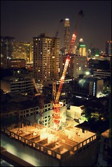 To infinity and beyond (bkiwik) Tags: city windows light building skyline architecture night digital canon lights evening construction asia crane dusk bangkok engineering mini jungle highrise cbd dslr siam minature tiltshift concretejungle towercrane krungthep eos400d craneage