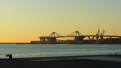 De camí a la feina (Jose Maria Sancho Aguilar) Tags: barcelona bridge sea españa port sunrise puerto puente lumix muelle mar spain europa europe mediterraneo day bcn catalonia panasonic clear amanecer catalunya grua cataluña espanya mediterrània fz38