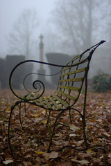 Cemetery bench, autumn fog (Skink74) Tags: uk autumn england mist 20d cemetery leaves fog bench spiral rust iron dof bokeh hampshire canoneos20d webs damp hursley wrought nikkor35f14 nikkor35mm114ai
