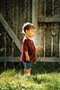 lost in thought on a golden summer day (Kathy Froilan) Tags: boy summer film water grass yard fence golden memories lawn spray scan sprinkler canoneos1 flickrchallengewinner thechallengefactory tcfwinner thepinnaclehof kanchenjungachallengewinner thepinnacleblog msh1211 msh12115 tphofweek128 settingsandlenshavebeenlosttotheagesprobablyatrusty70300mmwhichistillownanduse