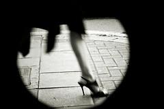 El glamour y el frío (una cierta mirada) Tags: street england bw woman london walking foot shoe highheels leg heel