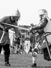 [2009-06-28@15.44.21a] (Untempered Photography) Tags: monochrome fight helmet battle medieval sword armour reenactment skirmish combatant chainmail platearmour chatteris gambeson mailarmour untemperedeye untemperedeyephotography chatterismedievalfestival2009