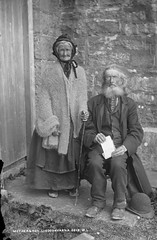 Mother & Son (National Library of Ireland on The Commons) Tags: mother son newtowncastle ballyvaughan clare ireland poem hat cravat beard glasses spectacles overcoat blackthornstick cardigan bonnet wrinkles 1890 1890s robertfrench portrait family knitted shawl williamlawrence lawrencecollection lisdoonvarna lyrics matchmaker connaught connacht nationallibraryofireland pareja ancianos fotoantigua