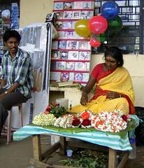Balloons and flowers (bokage) Tags: woman india man temple necklace cd garland vendor hindu madurai tamilnadu meenakshi