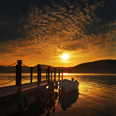Evening light, Ullswater (adrians_art) Tags: sunset sky cloud mountains water reflections boats pier jetty silhouettes hills cumbria ripples lakedistrictnationalpark lakeullswater