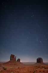 New Years With Mittens (Amicus Telemarkorum) Tags: longexposure blue camping winter red sky night stars december desert space newyear valley orion arizon monumentvalley constellations mesa mitten 2012 2011 navajonation