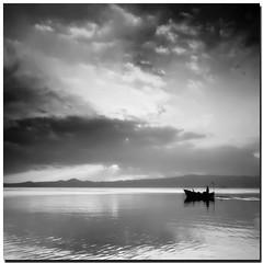 silenziosaMente (s@brina) Tags: sky italy lake clouds boat quiet silence lagodibolsena