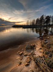 Bomstad beach (- David Olsson -) Tags: trees sunset lake cold beach reflections landscape sand nikon rocks sweden stones jetty january sigma karlstad 1020mm 1020 hdr vnern 2012 vrmland lakescape photomatix d5000 floatingpier bomstad davidolsson bomstadbadet ginordicjan ginordicjan12 bomstadcamping