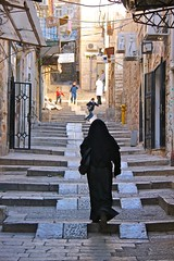 Woman Ascends the Old City Stairs (Eric Demarcq) Tags: woman canon children eos israel jerusalem 600 oldcity ericdemarcq womanascendstheoldcitystairs