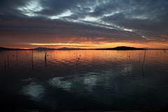Il tramonto del lago (da.geli) Tags: sunset italy lake water clouds umbria trasimeno mygearandme mygearandmepremium mygearandmebronze mygearandmesilver mygearandmegold