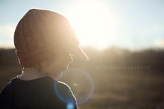 profile flare (staceymontgomery) Tags: winter light boy sun hat backlight warm profile warmth flare