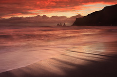 Fire Sunset - Reynisdrangar at Vk, Iceland (orvaratli) Tags: ocean travel sunset red sea seascape black beach rain landscape fire lava iceland sand waves atlantic arctic splash pinnacles seastack vk seacape reynisdrangar basaltcolumns reynsifjara