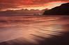 Fire Sunset - Reynisdrangar at Vík, Iceland (orvaratli) Tags: ocean travel sunset red sea seascape black beach rain landscape fire lava iceland sand waves atlantic arctic splash pinnacles seastack vík seacape reynisdrangar basaltcolumns reynsifjara
