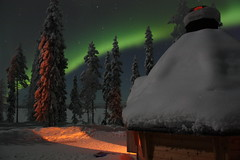 Northern Lights 2 (eagie1863) Tags: trees winter sky lake snow green night finland stars cabin glow hut skiresort aurora lapland kota northernlights auroraborealis solarflares lappish