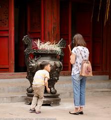 Inquisitive (Pexpix) Tags: child hanoi josssticks nikkoraf85mmf14d nikondf offering placeofworship prayers temple urn vietnam hni