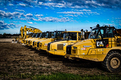 On your mark, get set...  (HTT) (13skies) Tags: yellow truck work moving big high construction driving large grand move dirt tall powerful dig larger haul linedup constructionequipment happytruckthursday