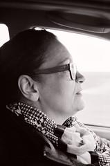 Driving, smoking (Ursus Bear) Tags: blackandwhite bw white black film monochrome car analog 35mm canon eos mono drive blackwhite driving monochromatic xp2 chrome 400 650 135 ilford ef f3545 3570 ilfordxp2400super bwwoman
