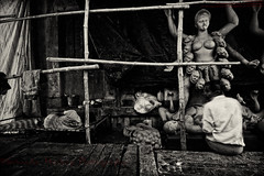 Amber Cast [ BW Version ] (Sukanta Maikap Photography) Tags: india streetphotography diwali kolkata calcutta westbengal kalipuja dipabali kumartuli tokina1116f28 goddesskaliidols clayidolshalffinishedidols unfinishedkaliidols canon450dtokinaatxprosd1116mmf28ifdx