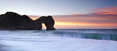 Durdle Door (peterspencer49) Tags: longexposure seascape beach clouds sunrise reflections coast unitedkingdom dorset coastline oceanview seaview coastalpath westcountry seaarch durdledoor jurassiccoast dorsetcoast southwestcoastalpath stunningview seascene limestonearch cliffwalks 5dmkll peterspencer stunningseascape beachseaview