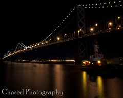 Bay Bridge Night Life (ChasedPhotography) Tags: ocean california longexposure bridge water night lights bay baybridge embarcadero bayarea sfbayarea sffd suspensionbridge fireboat sanfransisco