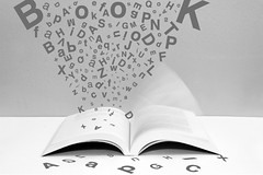 Open Book (fahid chowdhury) Tags: blackandwhite bw usa motion monochrome horizontal typography photography book flying blackwhite education open library text letters nopeople communication indoors learning alphabet helvetica ideas bold typeface regular sansserif westernscript
