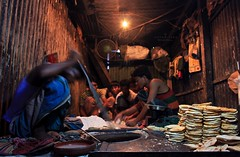 Bakarkhani Makers.... (Z A Y A N) Tags: street food motion canon photography eos living workers lowlight asia lifestyle biscuit dhaka bangladesh everydaylife peopleatwork childlabor 18mm southasia olddhaka hardworking 2011 zayan livelihood 550d bakarkhani southasianpeople rebelt2i kissx4 zayan1904 atibazar dhakaiya bakarkhanimakers gettyimagesbangladeshq12012