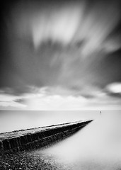 Dawlish (Explored on 17/12/2011) (paulwynn-mackenzie.co.uk) Tags: longexposure sea bw mist seascape nature clouds photoshop landscape photography pier seaside nice movement waves quiet sony relaxing kitlens clarity a33 structure walkway processing alpha dslr vignetting tones vignette minimalist slt pp lightroom dawlish postprocessing