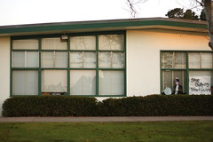 (Terin Talarico) Tags: california morning school light reflection window grass poster suburbia elvis fleeting bully bushes banal middleschool bullying 2011 sdusd justinbeiber