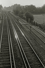 (Innis McAllister) Tags: morning travel blackandwhite monochrome metal train early vanishingpoint track empty tracks rail journey rails distance glint elevatedview