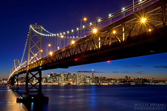 Gateway to the City (Willie Huang Photo) Tags: long bridge exposure island san francisco area landscape bay night city sunrise treasure cityscape bridge lights sf skyline scenic pier embarcadero