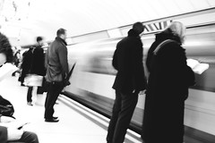 London, Liverpool Steet. (Elliott Steel) Tags: life people blackandwhite motion blur london contrast digital train portraits moving raw candid platform motionblur trainstation londonunderground depth liverpoolstreet centralline everydaypeople undergroundstation canon500d candidpeople elliottsteelphotography