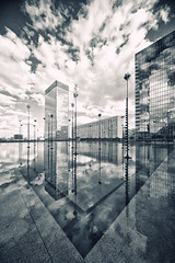 World Of Reflections (Philipp Klinger Photography) Tags: light shadow sky bw sculpture white house black paris france reflection building tower water glass lines architecture clouds contrast skyscraper reflections dark la blackwhite nikon frankreich europa europe tour first ladefense basin line esplanade