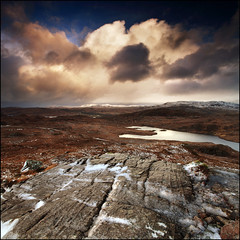 Snow Storm Kylesku & Loch Unapool (angus clyne) Tags: blue light wild cliff cloud white mountain snow storm west grass rain rock stone dark coast scotland highlands high wind time hill north deep scottish loch sutherland quinag kylesku unapool colorphotoaward sailgharbh