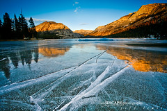 Calm Before the Storm (landESCAPEphotography | jeff lewis) Tags: park travel trees sunset usa lake mountains cold reflection 120 ice jeff forest canon landscape eos frozen nevada scenic lewis sierra alpine national yosemite dome 5d cracks landescape 1740 alpenglow tioga 1740l tenaya hwy120 landescapephotography