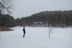 Day 21.366 (1-21-12) (Brian & Sierra) Tags: blue trees roof sky brown white house mountain snow black blur tree green project hair person grey blurry bush branch arms arm legs brian coat hill leg ground land snowing 365 pea bushes photostream greysky speck peacoat specks 366 snowyroof 365project brancges 366project