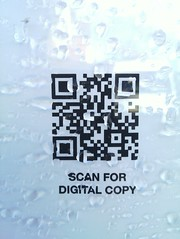 Rain-spattered QR code (nickj365) Tags: travel mobile train poster code tag rail scan barcode dorking 2d information qr firstgreatwestern timetable errorcorrection