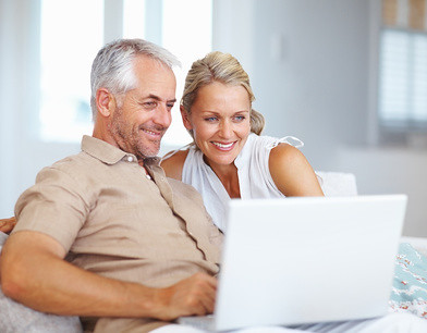 A happy aged couple surfing on a laptop by SalFalko, on Flickr