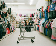 Dona Dona (Toyokazu) Tags: portrait girl kids shopping child cart pentax67