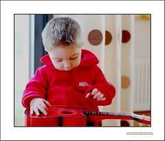 String change (Murtography) Tags: boy guitar son strings guitarstringredguitarnikon