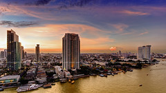 Chao Phraya River Sunset View / Bangkok (I Prahin | www.southeastasia-images.com) Tags: bridge sunset urban color skyline skyscraper river thailand boats hotel boat apartments view apartment traffic riverside dusk bangkok skytrain hdr chaophraya bts theriver peninsulahotel thelighthouse thonburi shuttleboat tonemapped hiltonmilleniumhotel taksinbridge raimonland therivercondominium
