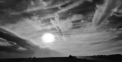 the lonely run... (BillsExplorations) Tags: sunset sky blackandwhite monochrome clouds illinois spring outdoor farm run lonely agriculture planting farmmachinery lonelyrun cloudsstormssunsetssunrises