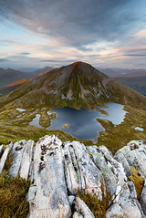 Mamore sunset (Camillo Berenos) Tags: uk greatbritain sunset mountain rocks vista loch viewpoint rugged munro lochan mamores scottishhighlands outdoorrecreation dramaticlight foregroundinterest rockyforeground