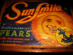 Sunsmile Pears Crate Advertisement - Smiling Sun 9316 (Brechtbug) Tags: california from blue orange sun smile smiling fruit illustration 1930s pears ad orb sunny creepy advertisement 1940s commercial anchor crate brand exchange 30s 40s sunsmile