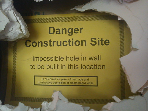 Danger Construction Site Impossible hole in wall to be built in this location To celebrate 25 years of marriage and constructive demolition of plasterboard walls