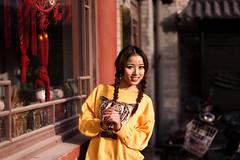 Tigress, Dongcheng - Beijing (adde adesokan) Tags: china street travel portrait people woman color girl face hair photography beijing streetphotography style stranger portrt schwarzweiss schwarz tigress pigtail streetphotographer dongcheng theblackstar streettogs