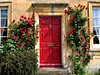 Red Door in the Cotswolds (UGArdener) Tags: red roses spring cotswolds villages gloucestershire doorways springtime redroses reddoors firstquality englishroses englishvillages englandinmay mellowcotswoldstone