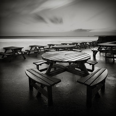 Tables (Andy Brown (mrbuk1)) Tags: ocean longexposure light sea cloud wet rain tarmac reflections square dawn mono blackwhite wooden devon seats repetition benches tones vignette mundane paignton leefilters bwfilters