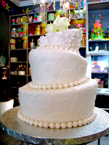 Baby 3-tier Mad Hatter wedding cake covered in white fondant ...